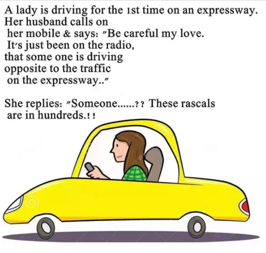 A Lady Driving a Car and Talking to Husband